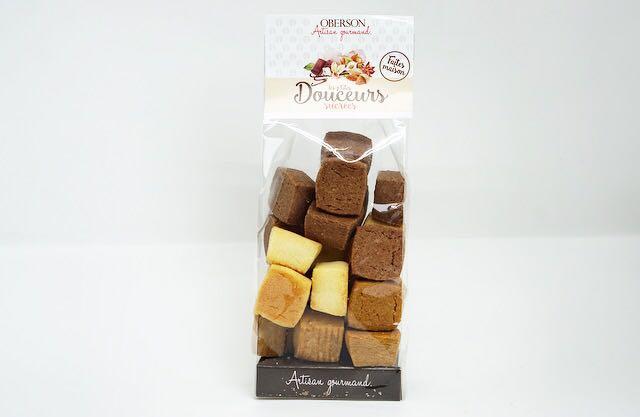 Trois sortes de minis sablés cubiques pur beurre, vanille, chocolat et café. Sachet de 150 gr